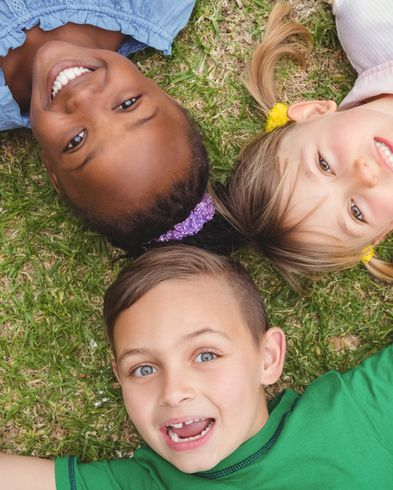 three-kids-children-together-happy-fun-grass-first-aid-workshop-save-life-emergency-training-provider-oxfordshire-england-united-kingdom-UK-saveyu